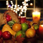 Beautiful Thanksgiving cornicopia filled with apples, squashes and pumpkins