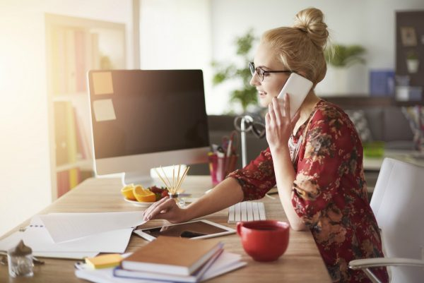 Young woman at office desk in home office