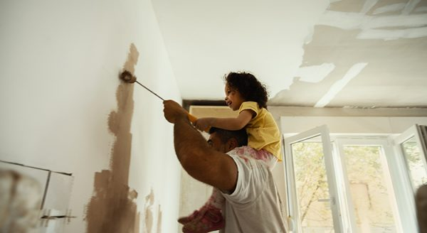 Young family renovating their home and painting