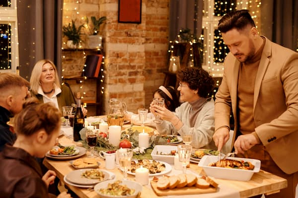 Family having holiday meal with white lights